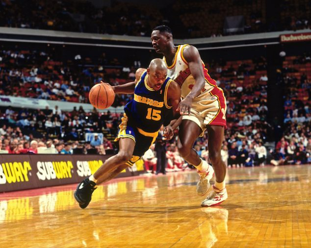 ATLANTA - 1994: Latrell Sprewell #15 of the Golden State Warriors dribbles against the Atlanta Hawks circa 1994 at the Omni in Atlanta, Georgia. NOTE TO USER: User expressly acknowledges and agrees that, by downloading and or using this photograph, User is consenting to the terms and conditions of the Getty Images License Agreement. Mandatory Copyright Notice: Copyright 1994 NBAE (Photo by Scott Cunningham/NBAE via Getty Images)
