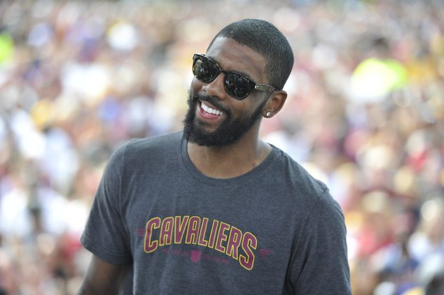 CLEVELAND, OH - JUNE 22: Kyrie Irving #2 of the Cleveland Cavaliers speaks to the fans during the Cleveland Cavaliers Victory Parade And Rally on June 22, 2016 in downtown Cleveland, Ohio. NOTE TO USER: User expressly acknowledges and agrees that, by downloading and/or using this Photograph, user is consenting to the terms and conditions of the Getty Images License Agreement. Mandatory Copyright Notice: Copyright 2016 NBAE (Photo by David Liam Kyle/NBAE/Getty Images)