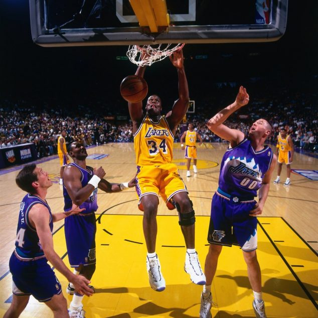 INGLEWOOD, CA - MAY 8: Shaquille O'Neal #34 of the Los Angeles Lakers dunks against the Utah Jazz in Game Three of the Western Conference Semifinals during the 1997 NBA Playoffs at the Great Western Forum on May 8, 1997 in Inglewood, California. The Lakers defeated the Jazz 104-84. NOTE TO USER: User expressly acknowledges and agrees that, by downloading and or using this photograph, User is consenting to the terms and conditions of the Getty Images License Agreement. Mandatory Copyright Notice: Copyright 1997 NBAE (Photo by Andrew D. Bernstein/NBAE via Getty Images)