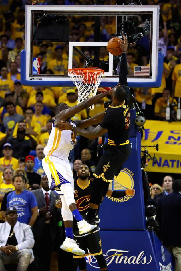 OAKLAND, CA - JUNE 19: LeBron James #23 of the Cleveland Cavaliers is fouled by Draymond Green #23 of the Golden State Warriors in Game 7 of the 2016 NBA Finals at ORACLE Arena on June 19, 2016 in Oakland, California. NOTE TO USER: User expressly acknowledges and agrees that, by downloading and or using this photograph, User is consenting to the terms and conditions of the Getty Images License Agreement. (Photo by Ezra Shaw/Getty Images)