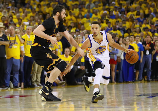 OAKLAND, CA - JUNE 19: Stephen Curry #30 of the Golden State Warriors handles the ball against Kevin Love #0 of the Cleveland Cavaliers during the second half in Game 7 of the 2016 NBA Finals at ORACLE Arena on June 19, 2016 in Oakland, California. NOTE TO USER: User expressly acknowledges and agrees that, by downloading and or using this photograph, User is consenting to the terms and conditions of the Getty Images License Agreement. (Photo by Ezra Shaw/Getty Images)