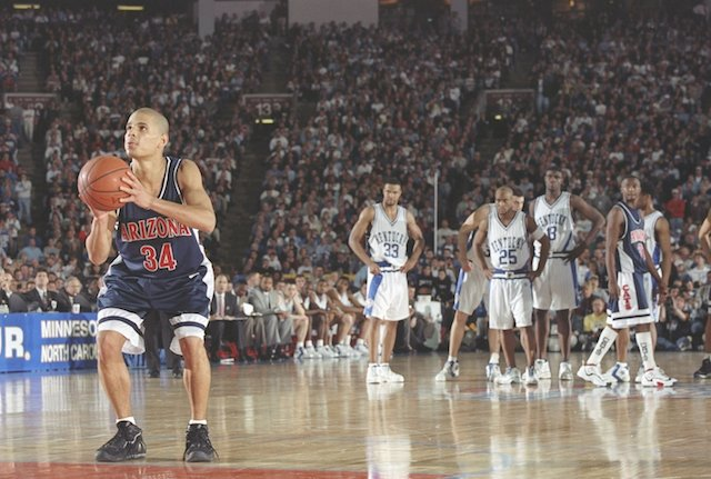 31 Mar 1997: Guard Miles Simon of the Arizona Wildcats prepares to soot the ball during the NCAA Championship game against the Kentucky Wildcats at the RCA Dome in Indianapolis, Indiana. Arizona won the game 84-73.
