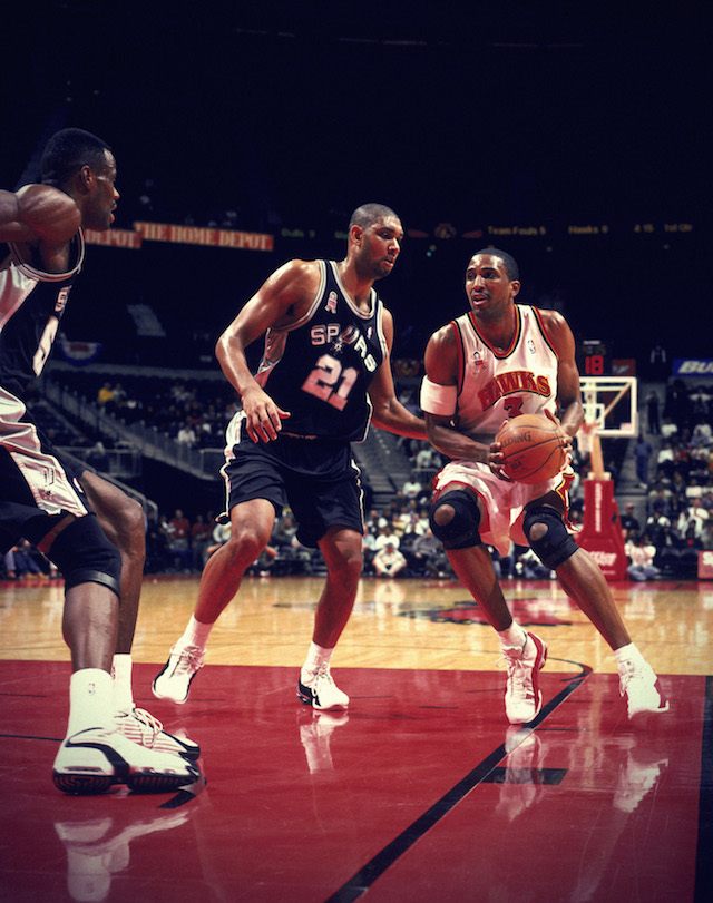5 Dec 2001: Forward Shareef Abdur-Rahim #3 of the Atlanta Hawks holds the ball as forward Tim Duncan #21 of the San Antonio Spurs plays defense during the NBA game at the Phillips Arena in Atlanta, Georgia. The Spurs defeated the Hawks 120-112. NOTE TO USER: User expressly acknowledges and agrees that, by downloading and/or using this Photograph, User is consenting to the terms and conditions of the Getty Images License Agreement. Mandatory copyright notice: Copyright 2001 NBAE Mandatory Credit: Scott Cunningham /NBAE/Getty Images