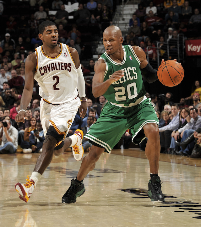 CLEVELAND, OH - JANUARY 31: Ray Allen #20 of the Boston Celtics makes a move aware that Kyrie Irving #2 of the Cleveland Cavaliers is closing in behind him at The Quicken Loans Arena on January 31, 2012 in Cleveland, Ohio. NOTE TO USER: User expressly acknowledges and agrees that, by downloading and/or using this Photograph, user is consenting to the terms and conditions of the Getty Images License Agreement. Mandatory Copyright Notice: Copyright 2012 NBAE (Photo by David Liam Kyle/NBAE via Getty Images)