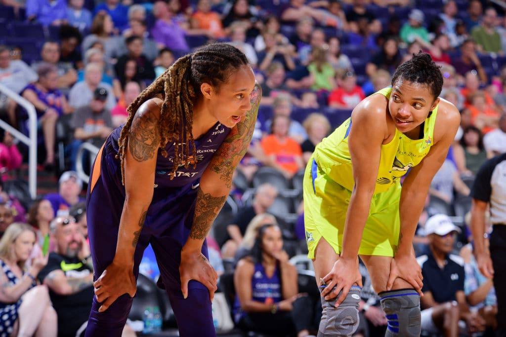 Brittney Griner of the Phoenix Mercury and Imani McGee-Stafford of the Dallas Wings