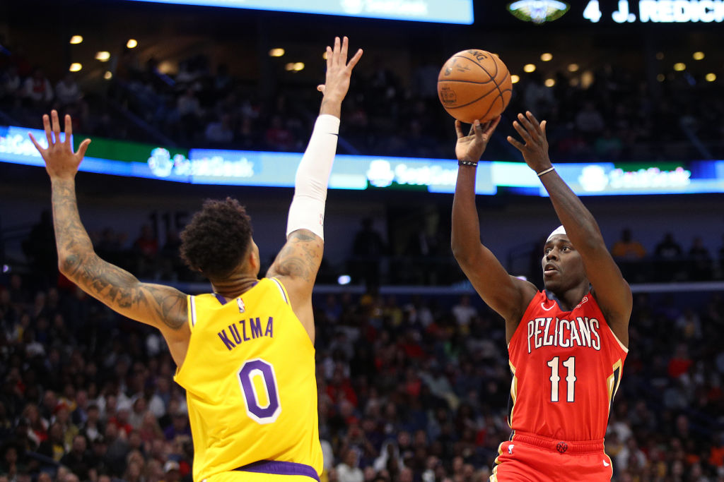 Jrue Holiday of the New Orleans Pelicans, Kyle Kuzma of the Los Angeles Lakers