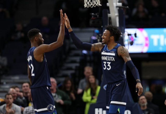 Andrew Wiggins, Robert Covington of the Minnesota Timberwolves