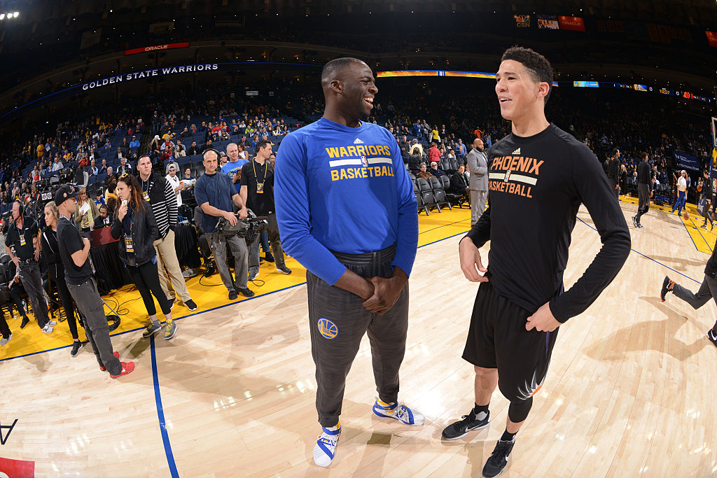 Draymond Green of the Golden State Warriors, Devin Booker of the Phoenix Suns