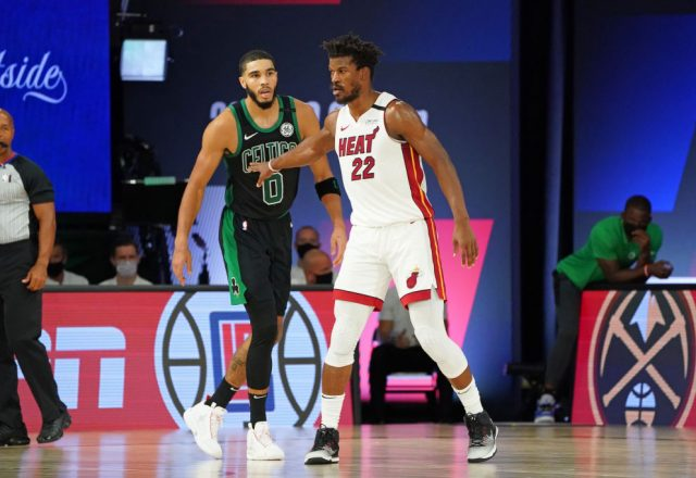 Jayson Tatum of the Boston Celtics and Jimmy Butler of the Miami Heat