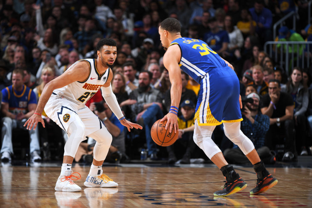 Jamal Murray of the Denver Nuggets and Steph Curry of the Golden State Warriors