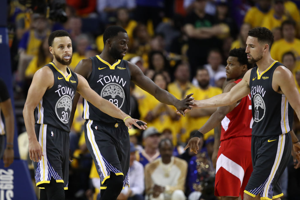 Steph Curry, Klay Thompson, and Draymond Green of the Golden State Warriors