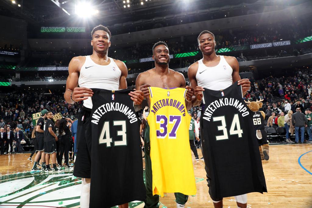 Giannis Antetokounmpo and Thanasis Antetokounmpo of the Milwaukee Bucks, Kostas Antetokounmpo of the Los Angeles Lakers