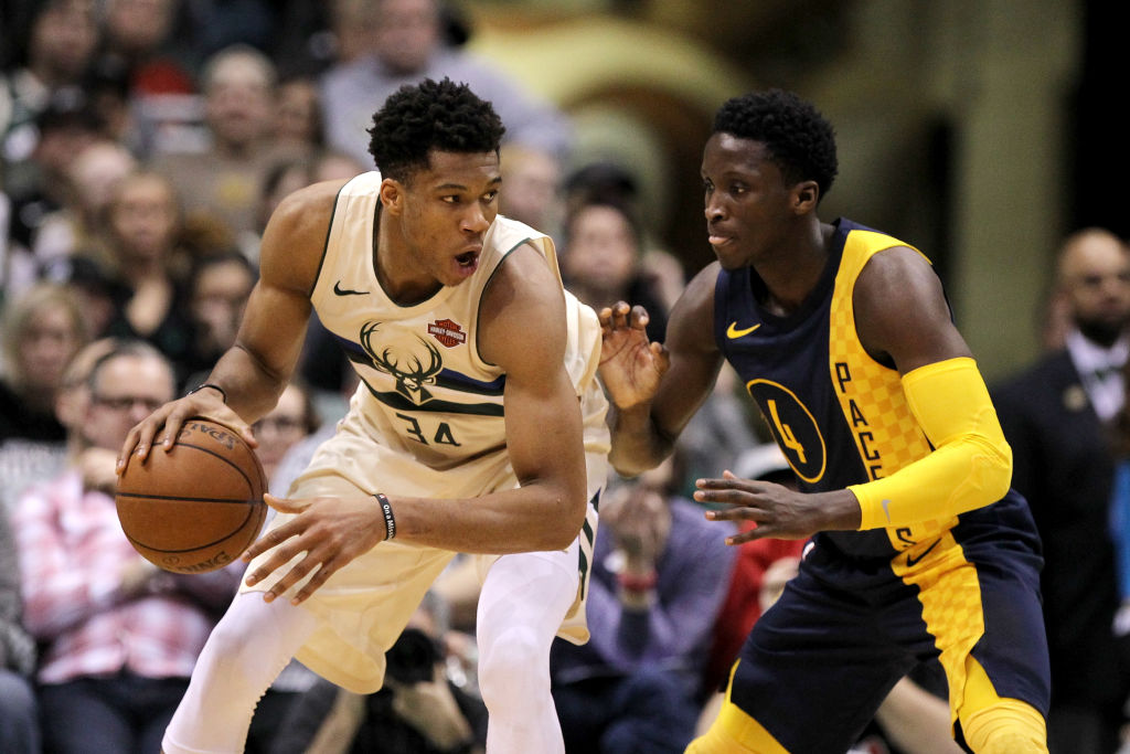 Giannis Antetokounmpo of the Milwaukee Bucks and Victor Oladipo of the Indiana Pacers