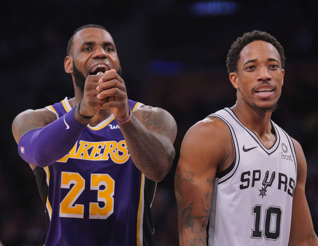 LeBron James of the Los Angeles Lakers and DeMar DeRozan of the San Antonio Spurs