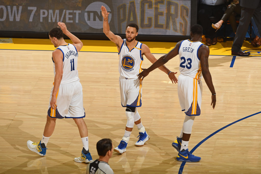 Steph Curry, Draymond Green, and Klay Thompson of the Golden State Warriors